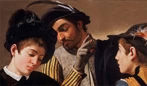 L'immagine raffigura un dettaglio de I Bari di Caravaggio